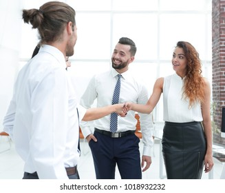 business women greet each other with a handshake