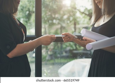 Business women hand giving name card