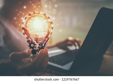 Business women hand holding light bulb, concept of new ideas with innovation and creativity / soft focus picture / Vintage concept