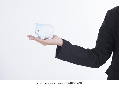 business women hand holding piggy bank. concept saving finance and investment.