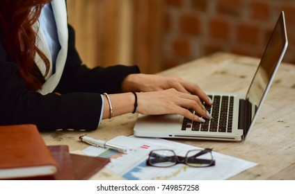 business women hand typing on laptop keyboard, network communication or finance concept.