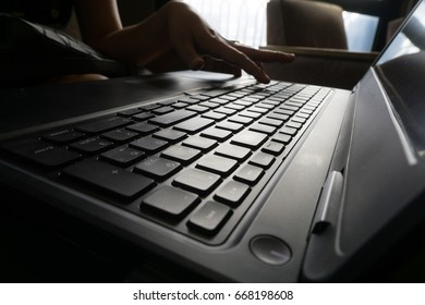 business women hand working with laptop doing job or online business to sell something.thai keyboard
