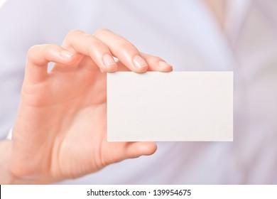 Business women handing a blank business card