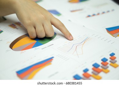 business women hands and finger point on business document during planing target goal. business concept.