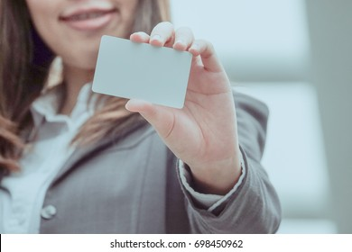 business women holding small card in hand