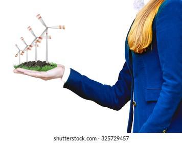 A business women holding windmills symbolizing green energy