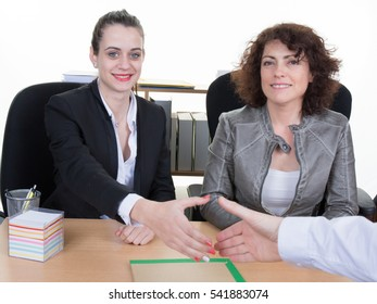 Business women interviewing male job applicant in office
