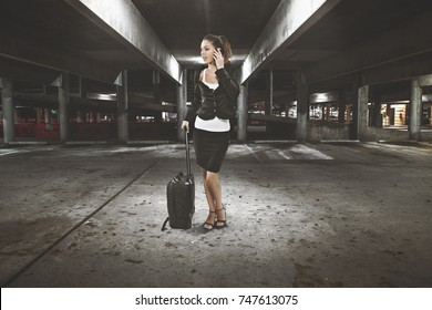 business women into a desolated car park area talking on phone
