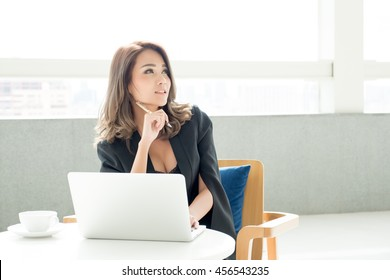 business women pondering over ideas in office
