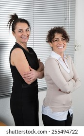 Business women  are posing at office