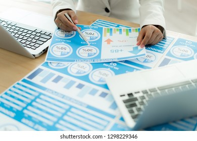 Business women reviewing data in financial charts and graphs. Accounting