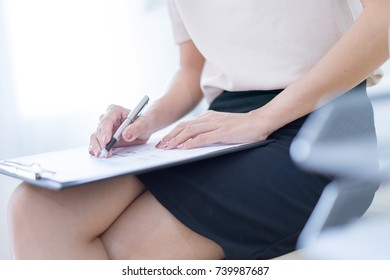 Business women reviewing data in financial charts and graphs in the office
