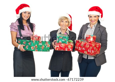 51051ce76da21 Business women with Santa hats holding colorful Christmas gifts and smiling  isolated on white background