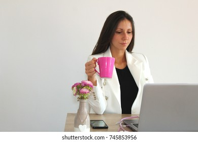Business women sitting on her job.