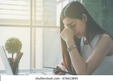 Business women stressed and under pressure, selective focus, Young beautiful asian businesswoman tired from work in the office