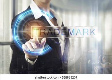 Business women touching the trademark screen
