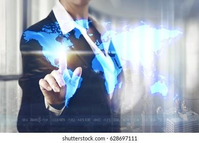 Business women touching the World screen