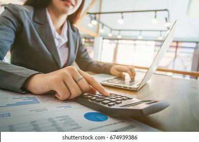 business women using calculator.