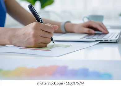 Business women using laptop and   analysis financial document