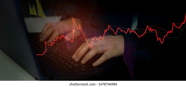 Business women using laptop computer with screen interface,stock chart with concept of investing in stock exchange, exchange rates,risk and volatility analysis currency fluctuations in world market