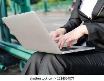 Business women using notbook,women using hand press computer keyboard,selective focus