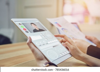 Business women are using a tablet screen with a video call teams. Video Calling is a technology that makes communication fast and error-free.