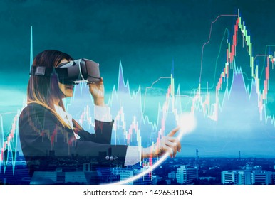 Business women wearing VR headsets using finger touch to check stock charts,holographic screen interface,concept of  speculation from currency exchange rates and volatility stock trading stock market