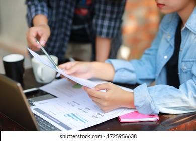 Business women is working on desk office with her computer laptop and writing accounts for investment of management