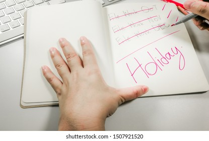 Business and workers are checking to-do list and Work completed on Notebook for ready to go on Holidays vacation . and dreaming about New Year holidays