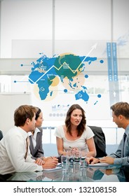 Business workers using blue map diagram interface in a meeting
