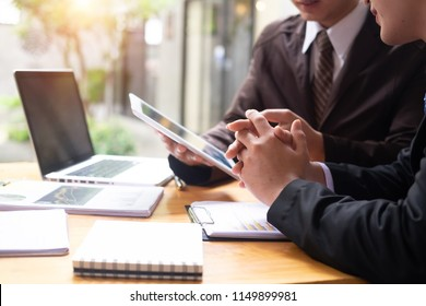 Business working consult discussion on work table with tablet.