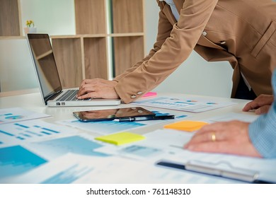 Business working at office with laptop and documents on his desk. Business concept.