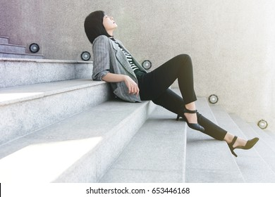Business Working Woman sit on stair in sexy relaxation posture, closed eyes and thinking for solution or success in life and work, side view