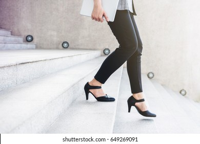 Business working woman steps walking down stair at office outdoor, side view, Lifestyle and Motivation of modern female concept