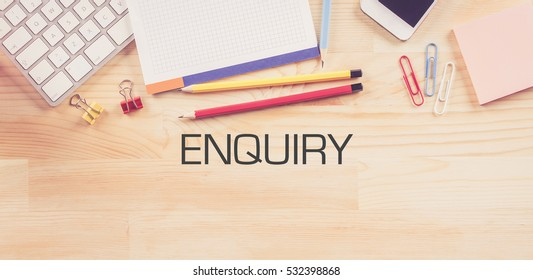 Business Workplace with  ENQUIRY Concept on Wooden Background