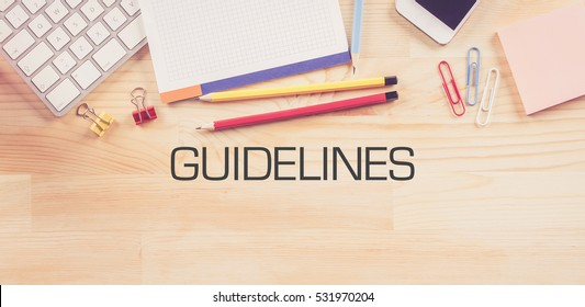 Business Workplace with  GUIDELINES Concept on Wooden Background