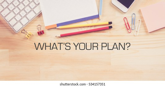 Business Workplace with  WHAT'S YOUR PLAN? Concept on Wooden Background