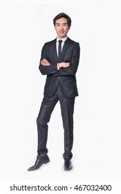 Business young man of Asian, full length portrait isolated in studio