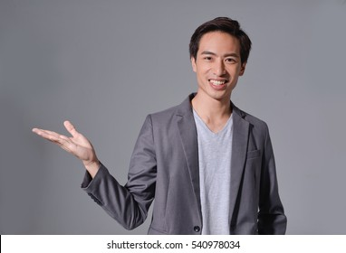Business young man with hand gesture isolated-gray background