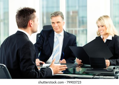 Business - young man sitting in job Interview