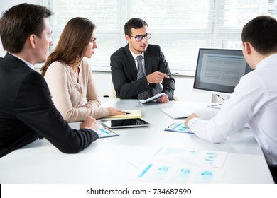 BusinessBusinesspeople discuss a new project in the officepeople discuss a new project in the office