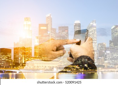 Business,communications,connection,technology concept.Double exposure businessman using smartphone upload data Business over blurred city scape.select focus.flare light