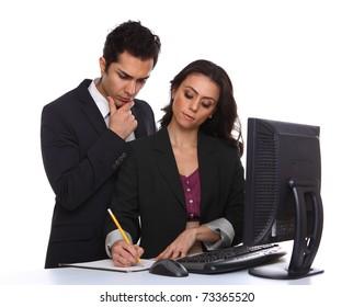 Businesscouple problemsolving near a desktop computer