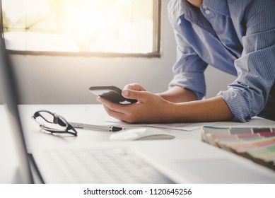 Businesses work through smartphones and laptop in the workplace to communicate and Meeting report in progress collaborate with business teams.
