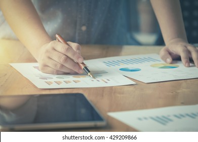 businessgirl working on Desk office business financial accounting calculate, Graph analysis, vintage color