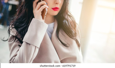 Businesslady answers an important Call in a office center building. Concept of successful business. Reliable Communication, Connection.