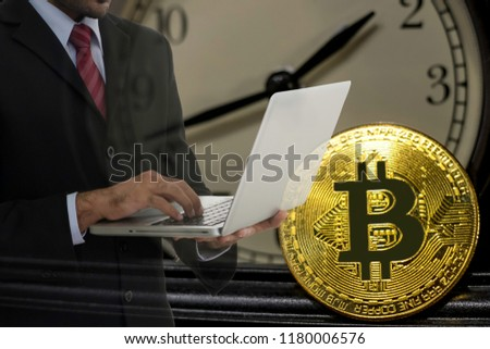 Businessman accelerates investment to compete in time, golden bitcoin symbol of bitcoin crytocurrency from blockchain technology, finance concept