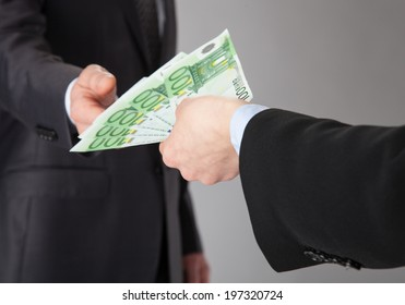 Businessman accepting money offer on grey background
