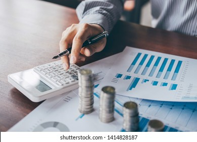Businessman accountant counting money and making notes at report doing finances and calculate about cost of investment and analyzing financial data, Financing Accounting Banking Concept.