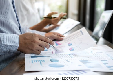 Businessman accountant and secretary making working audit and calculating expense financial annual financial report balance sheet statement, doing finance making notes on paper checking inspection.